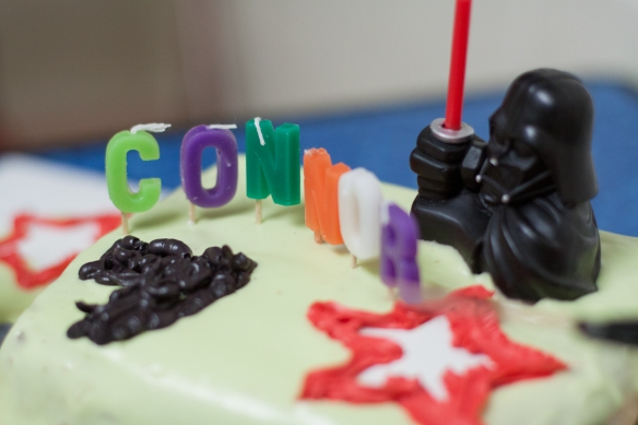 the cake. notice the seven candles. connor figured that out on his own at party city. connor equals six + one darth vader = seven
