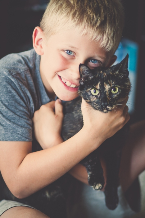 a boy and his ... cat.